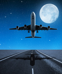 Landing passenger airplane in night