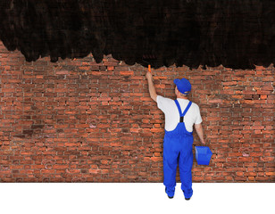 house painter covers brick wall