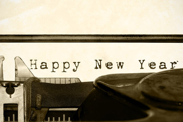 "Inscription ""Happy New Year"" written on an old typewriter"