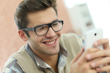 Young man connected on internet with smartphone
