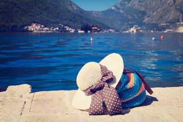 hat and beach bag near the sea in Montenegro