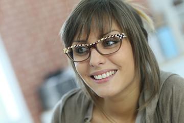 Smiling young woman wearing eyeglasses