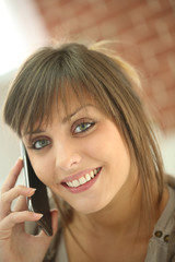 Closeup of young woman talking on mobile phone