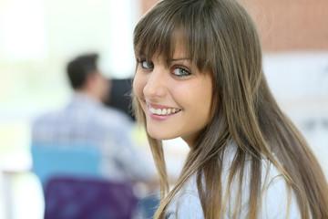 Student girl with long hair looking at camera