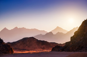 Fantastic landscape with mountains at sunset
