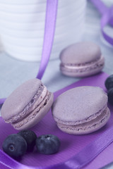Violet French macaroons cookies and blueberries