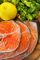 Delicious  portion of fresh salmon fillet with lemon and parsley