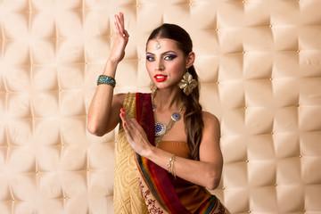 European woman posing in Indian Style