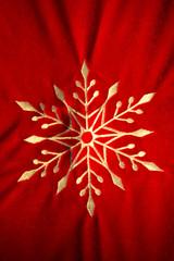 embroidered white snowflake on red velvet
