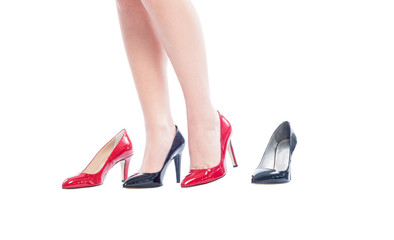 Woman legs with different color shoes.