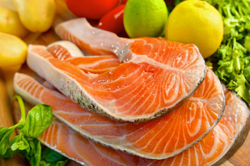 Delicious  portion of fresh salmon fillet with vegetables