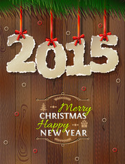 New Year 2015 of torn paper against wood background