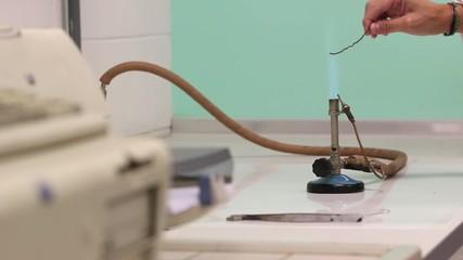Powder test with a bunsen burner in a lab
