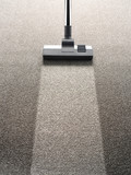 Vacuum cleaner on a carpet with an extra clean strip - 73365758