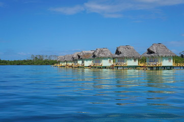 Caribbean overwater bungalows with thatched roof
