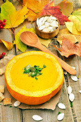 Pumpkin soup on rustic table