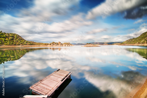 canvas print picture Completely calm lake with small jetty and reflections