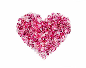 Red heart made of precious stones on white background