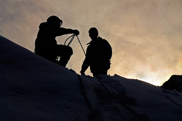 Mountaineers in sunset
