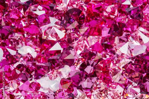 Leinwandbild Motiv Closeup photo of many small ruby and diamond stones