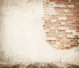 Fototapety Tal brick wall with wooden floor