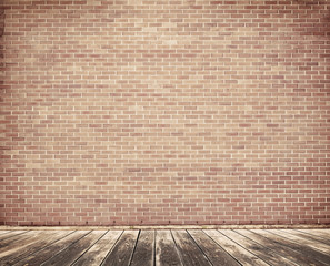 Tal brick wall with wooden floor