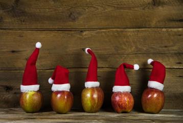 Weihnachtlicher Holz Hintergrund mit Äpfel: Weihnachtskarte