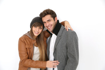 Trendy loving couple standing on white background