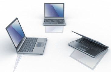 Three laptops isolated over white background