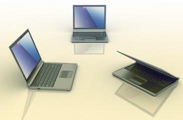 Three laptops isolated over white background