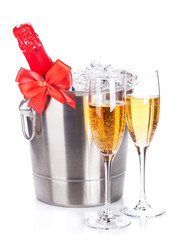 Two champagne glasses and bottle in cooler