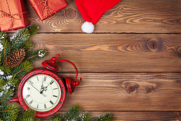 Christmas background with clock, snow fir tree and gift boxes