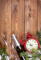 Christmas background with clock, snow fir tree and champagne
