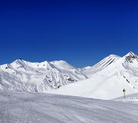 Ski slope and warning sign