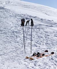 Skiing equipment on ski slope at sunny day