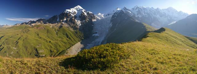 Mountain ridge in Caucasus with beautiful peaks in summer