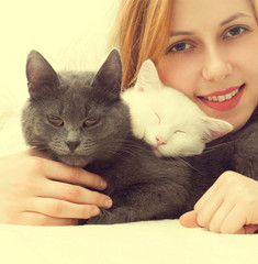 beautiful girl and two cats