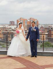 Wedding couple against modern city