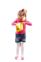 Little girl with shopping bag isolated on white