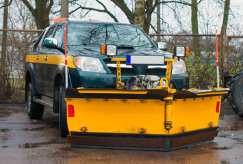 Car with plow-frame. Winter road services are ready for winter.