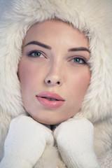 Young woman wearing a fur cap