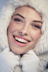 Happy woman wearing a fur cap