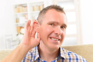 Man showing deaf aids