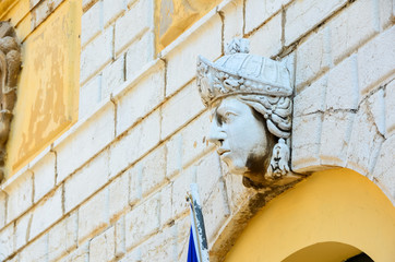 head detail on a wall, Venetian architecture