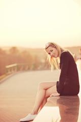 beautiful blonde girl portrait on the street