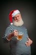 Handsome sailor. Seaman. Santa claus with beer