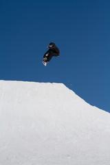 Snowboarder jumps in Snow Park,  ski resort