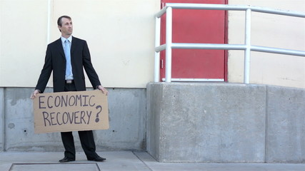 Businessman Economic Recovery Sign