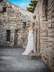 Pretty bride standing or posing, outdoors