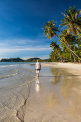 Man relax walking on the  tropical beach costline